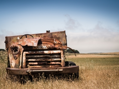 Rusted old truck abandoned in paddock