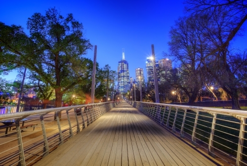 Pedestrian bridge in Birrarung Marr looking towards the city at night
