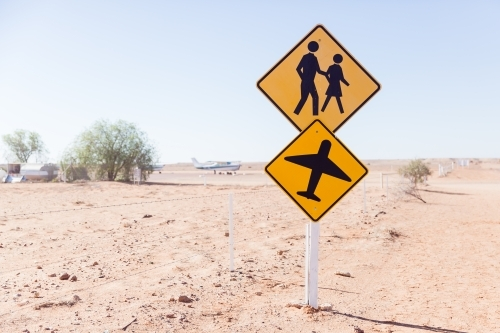 People and Plane Sign in the Outback