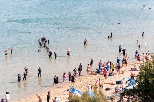 People at the beach participating in a Triathlon charity event