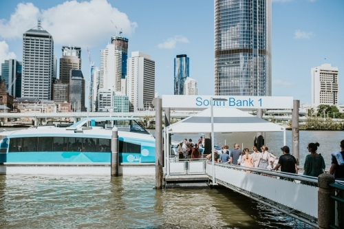 People lined up to board the City Cat boat at South Bank