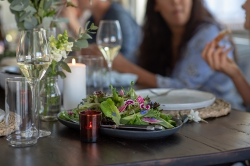 People Sharing Healthy Meal at Rustic Table Setting