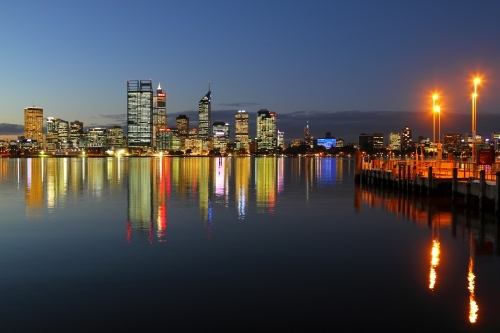 Downtown city lights of Perth CBD reflecting on the Swan River.