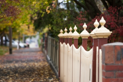 Picket fence on a tree lined footpath