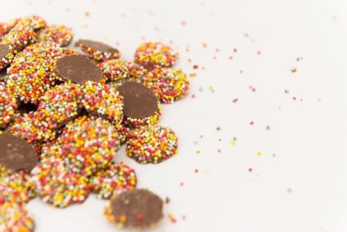 pile of chocolate freckles with sprinkles