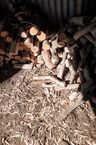 Pile of firewood in sunlit shed