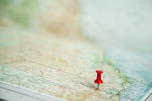 Pin marking road trip destination on map