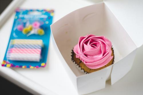 Pink cupcake and birthday candles