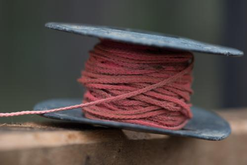 Pink string line resting on top of hardwood
