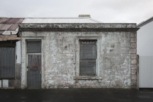 Abandoned grey building on overcast day