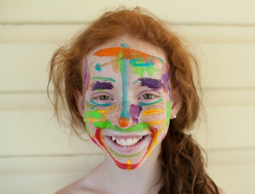 Portrait of a girl with paint on her face