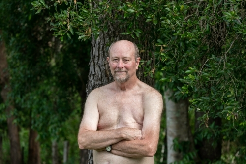 Portrait of a male breast cancer survivor standing outdoors