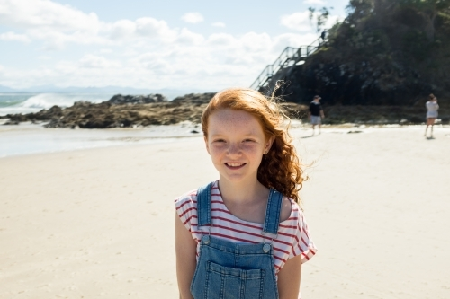 Portrait of a young girl smiling at the beach