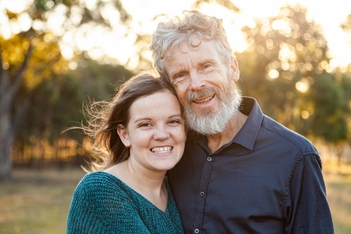 Portrait of father and smiling daughter together