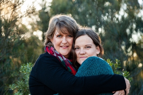 Portrait of mother and daughter embracing in hug