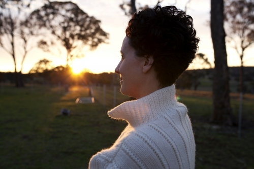 Portrait of woman looking away in the sunset