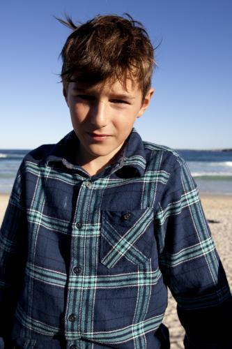 Portrait of young boy at the beach