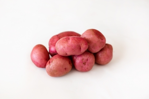 Potatoes on white backdrop