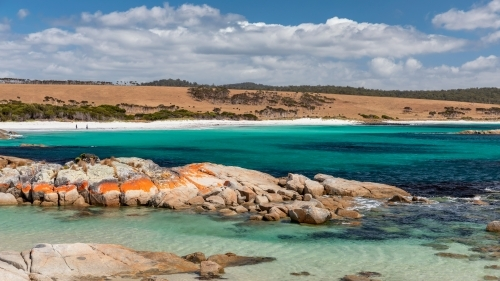 Pristine turquoise water, white sand & orange rocks at Bay of Fires, Tasmania