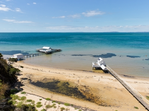 private jetties and boatsheds from coastal walkway