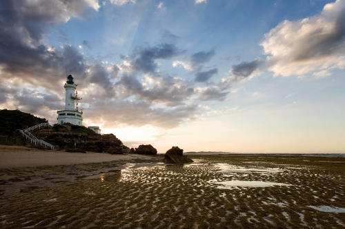 Landscape of lighthouse and beach at low tide