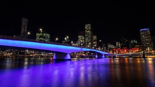 Purple lights over bridge and river