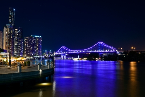 Purple reflections on the Brisbane River with the Storey Bridge and a dark blue night sky