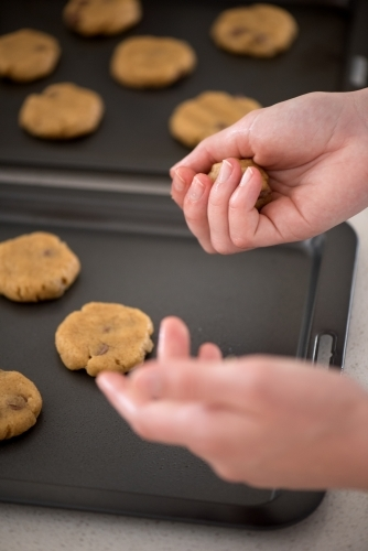 Putting cookie dough onto baking trays