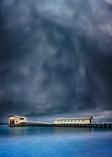 Queenscliff Pier with dramatic grey clouds overhead