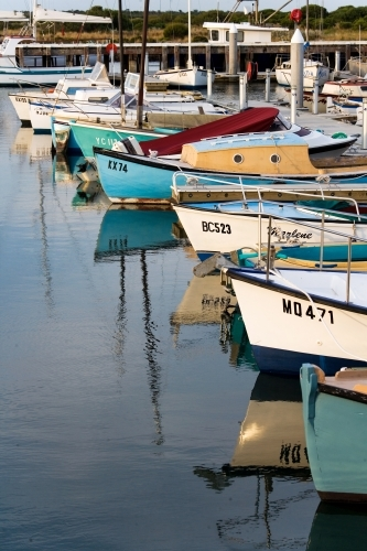 Vertical aspect of boats lined up at a harbour