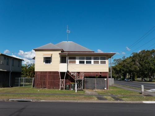 Queenslander style house in town elevated off the ground