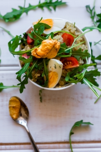quinoa salad with chicken, egg, rocket and mustard