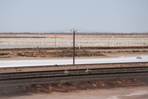 Rail line with salt lake in background