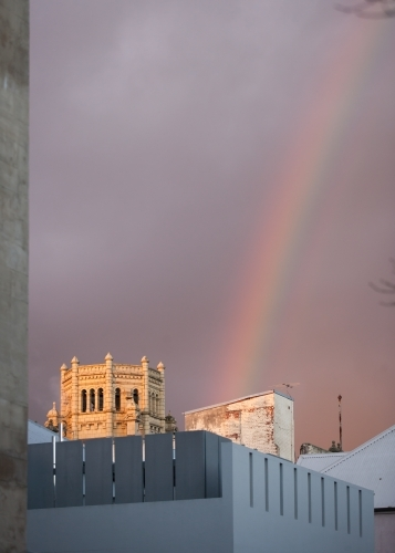 Rainbow above buildings in a city
