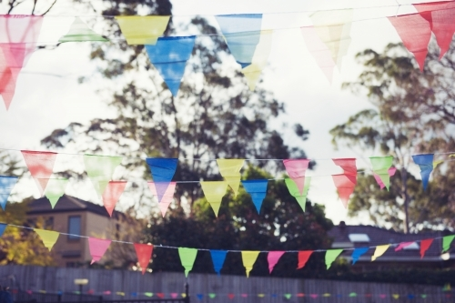 Rainbow flags at backyard party
