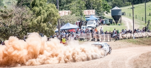 Rally car creating a dust cloud