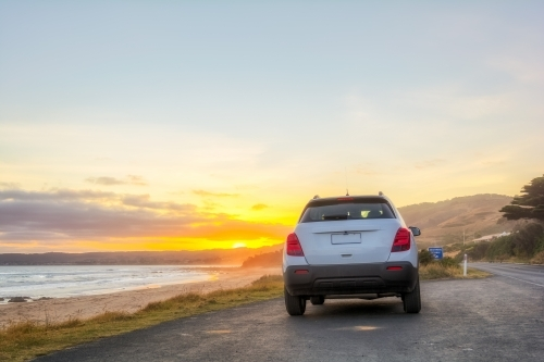 Rear view of car at sunset