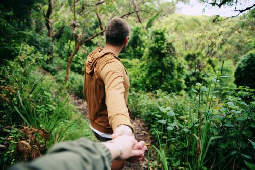 Holding Hands Walking in the Bush