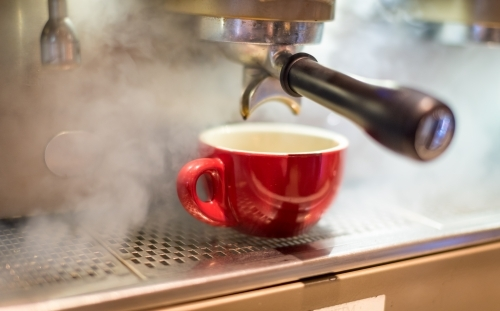 Red coffee cup on coffee machine