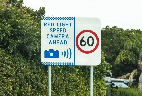 Red light speed camera ahead warning sign and 60 sign