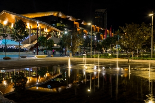 Reflection of the night lights in the forecourt fountain at Darling Harbour, Sydney