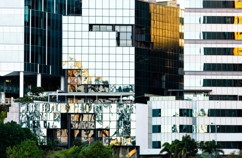 Reflections and geometric patterns in city buildings creating abstract effect