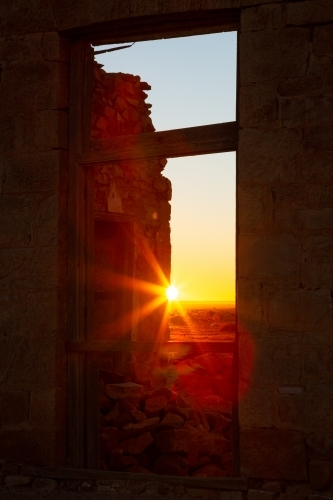 rising sun through window in a ruin