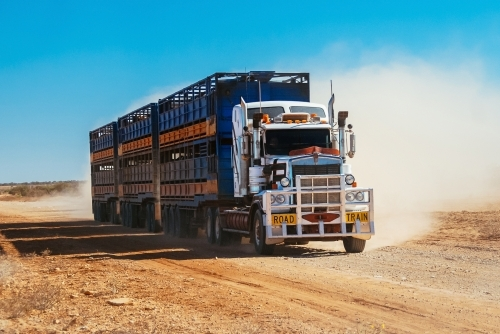 Road train in the Outback on a dirt road