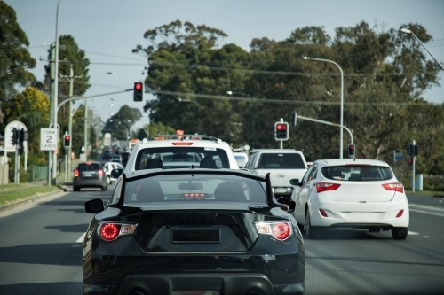 Cars stopped on the road at red traffic lights