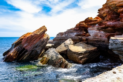 Rocky coastline with ocean and blue sky