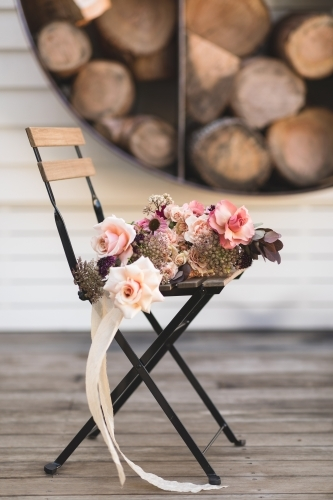 Rose Bouquet with Ribbon on Rustic Seat