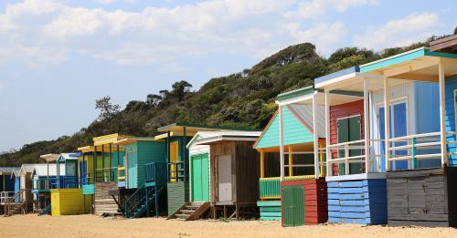 Row of bright beach boxes on a sunny summers day