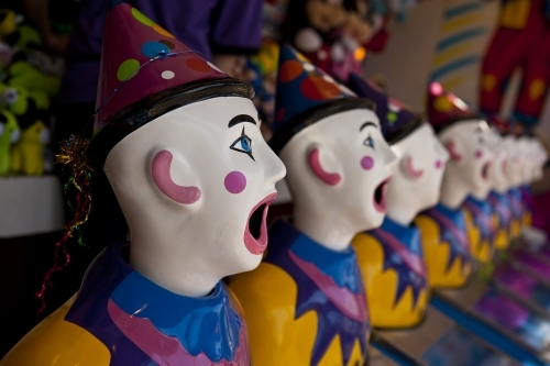 Row of clown heads, turning away