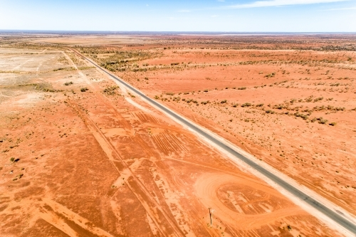 Rural highway cuts through western Queensland in drought.